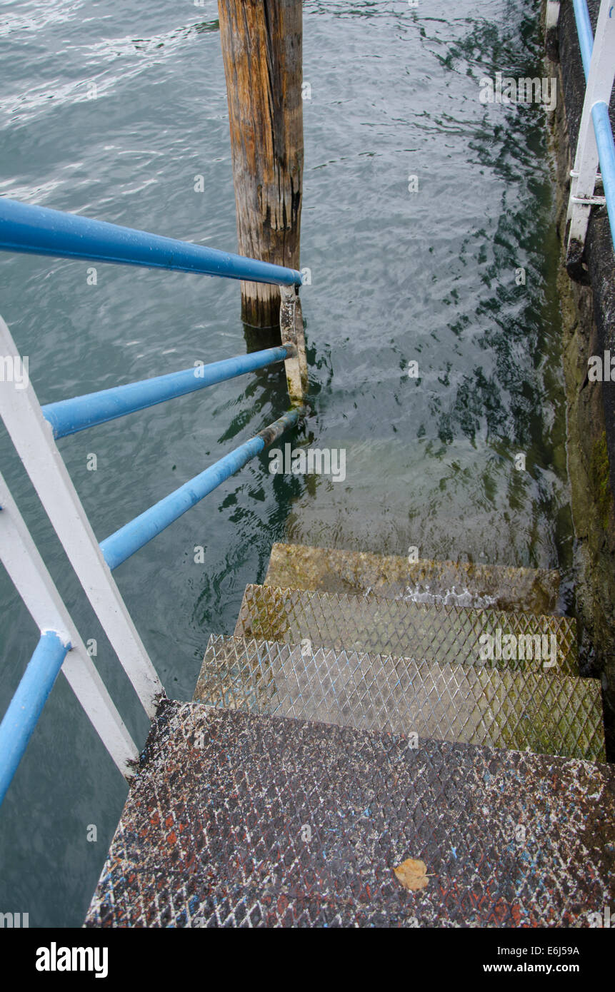 Staircase down to Lake Iseo or Lago d'Iseo or Sebino with the quai, Lombardy region. Northern Italy. - Stock Image