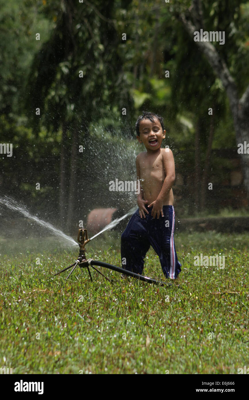 cheerful boy play in park - Stock Image