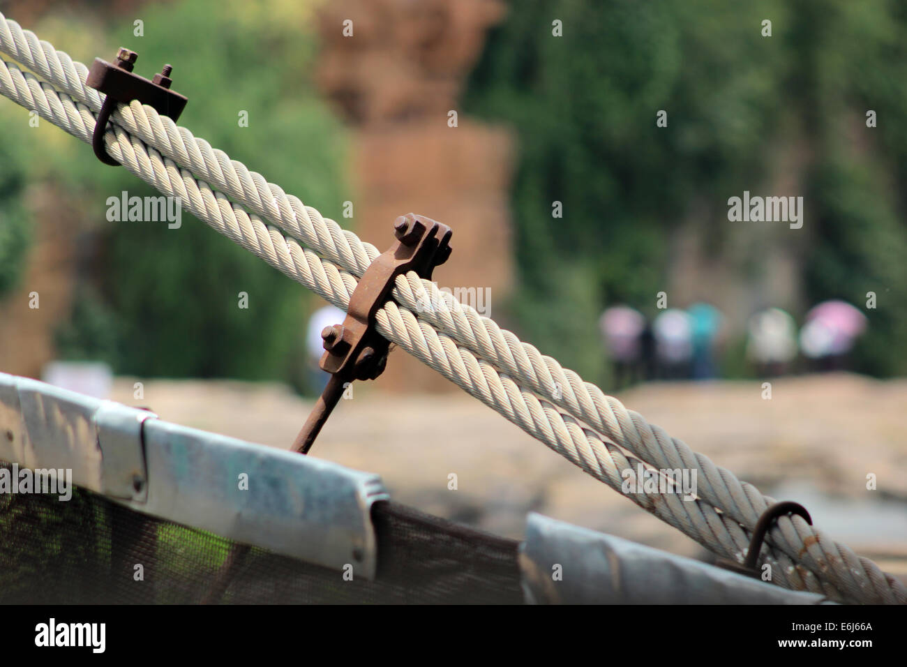 A strong iron rop with nut and bolt  in rope bridge for support . image is taken from noon time in gokak falls cotton Stock Photo