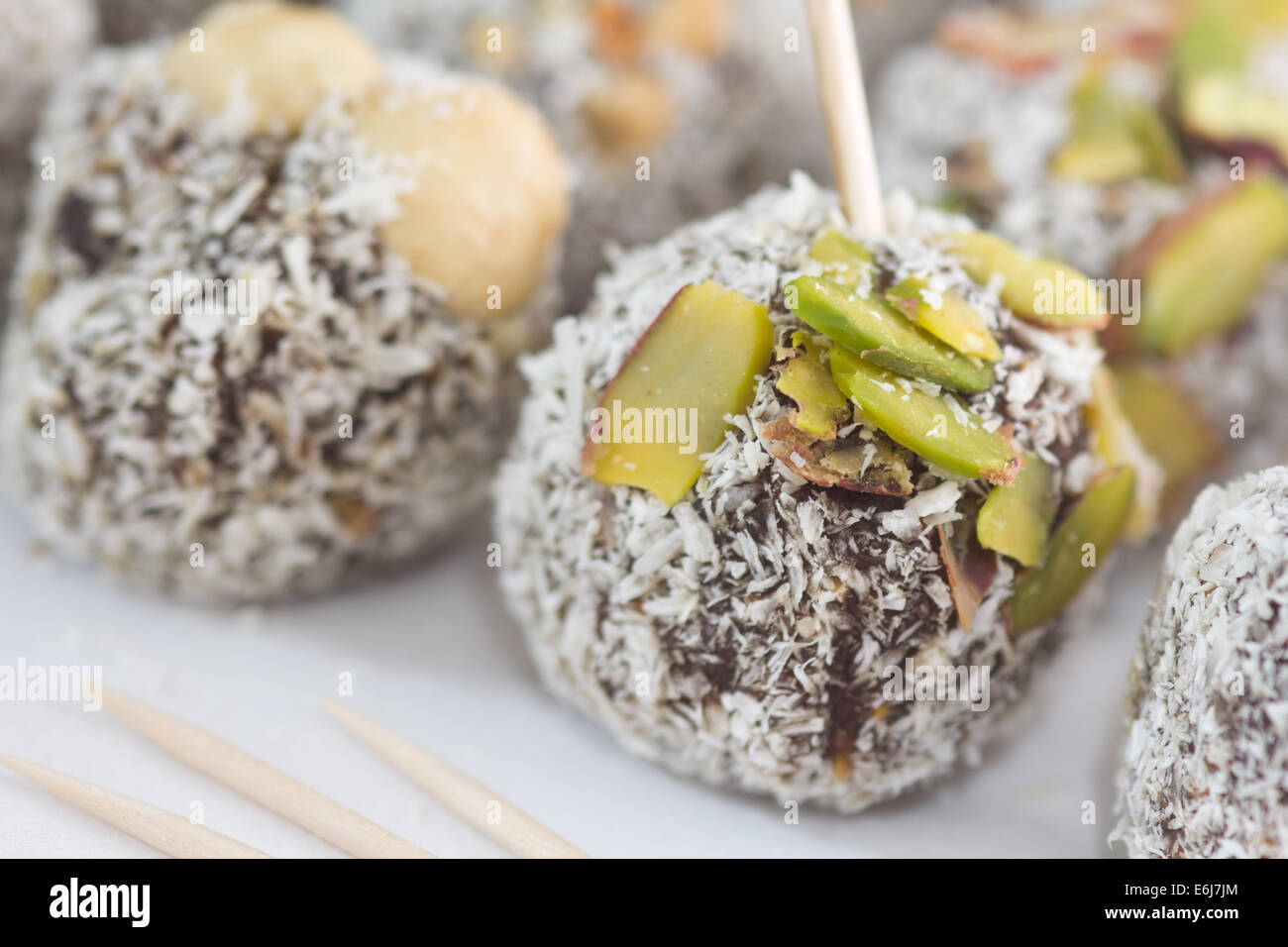 Special Turkish Fig Dessert topped with coconut powder, nuts and pistachio. Stock Photo