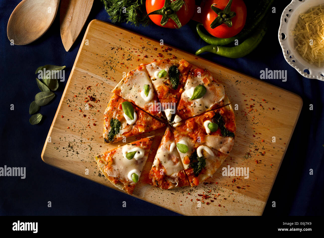 Italian pizza with mozerellla on dark and mood table setting Stock ...