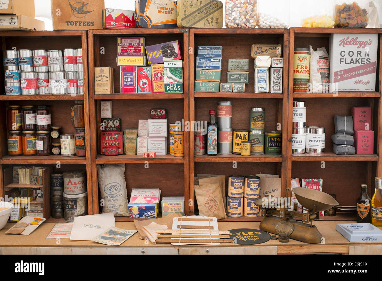 1940s replica grocers shop with packets of food and household items on the shelves at a historical military Reenactment - Stock Image