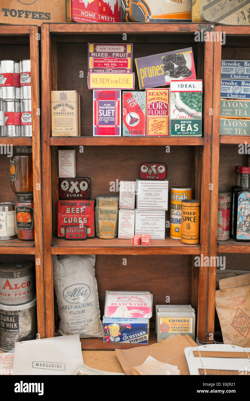 1940s replica grocers shop with packets of food and household items on the shelves at a historical military Reenactment Stock Photo