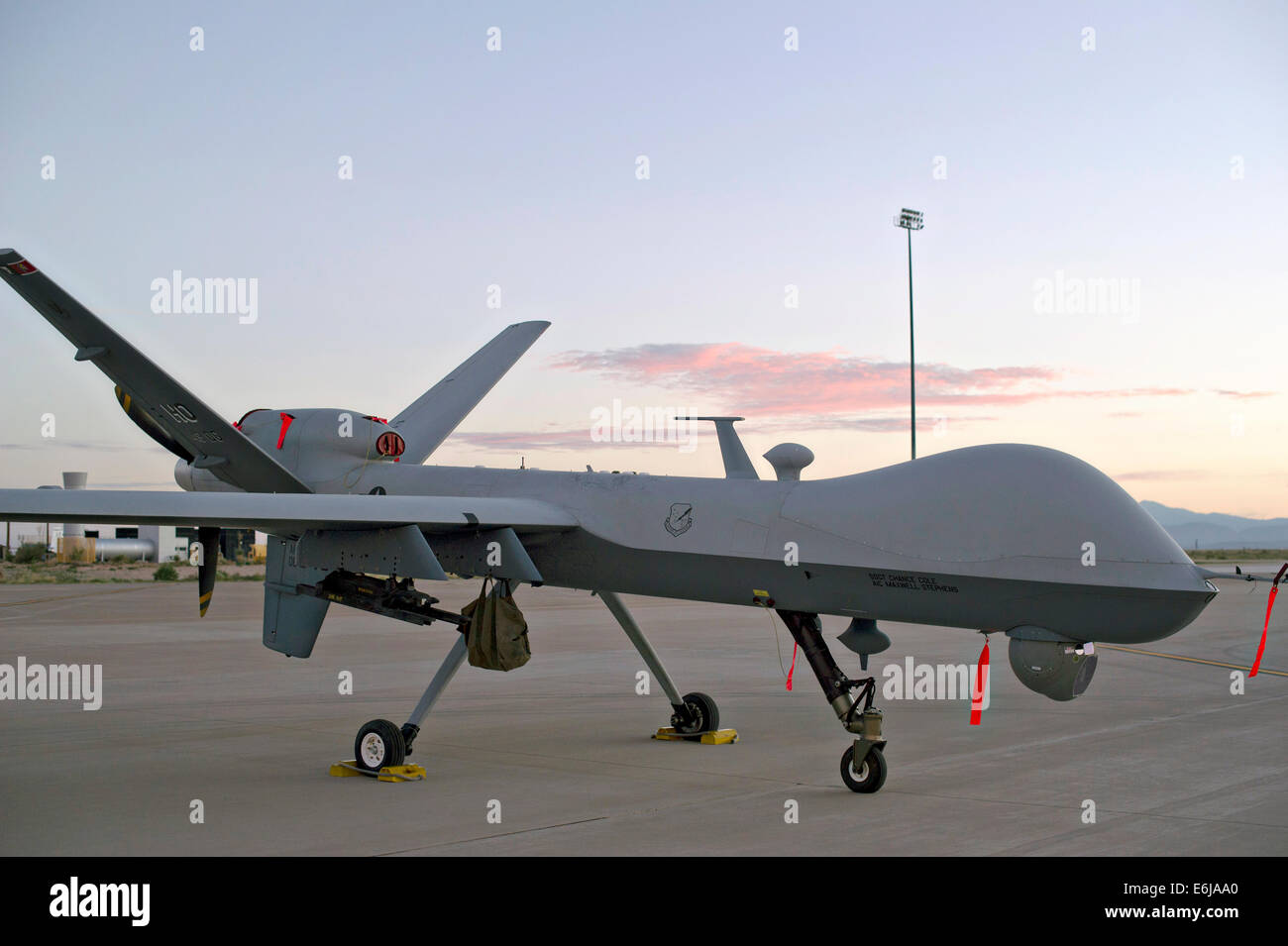 An MQ-9 Reaper parked on the flight line of Holloman Air Force Base August 19, 2014 in Alamogordo, New Mexico. - Stock Image