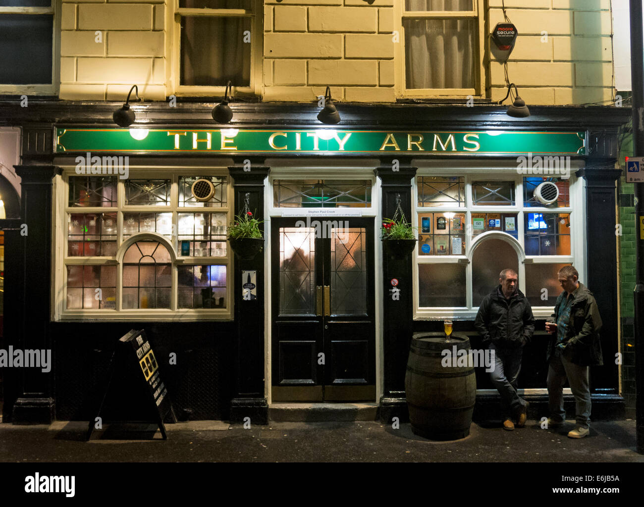 The City Arms Pub, Manchester, NW England, United Kingdom in the early evening - Stock Image