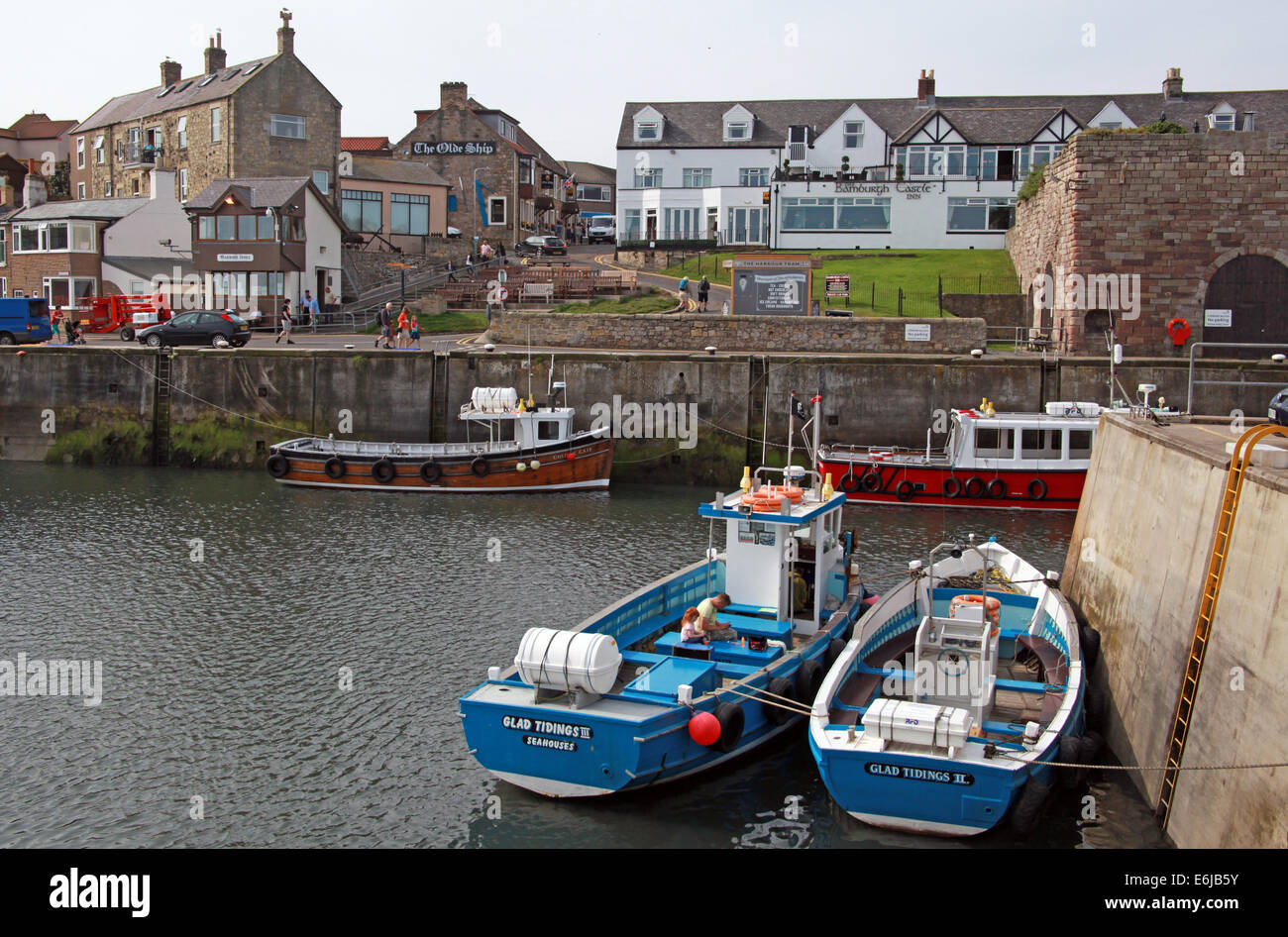 Boats in Seahouses harbour, Northumbria, NE England, UK - Stock Image