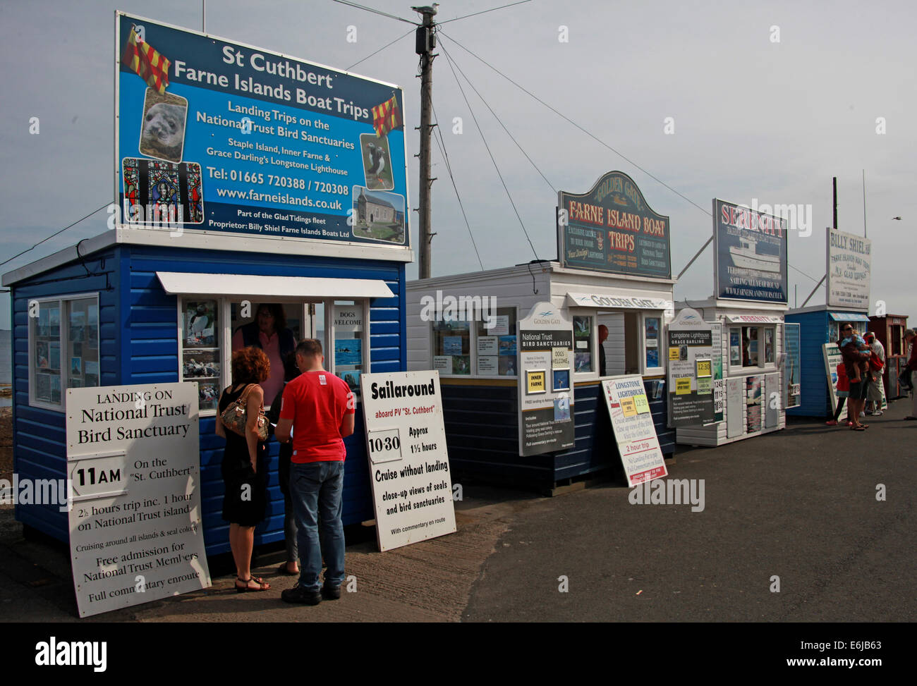 St Cuthbert boat Tickets being sold from sheds at Seahouses, for Farne Island trips, NE England, UK - Stock Image