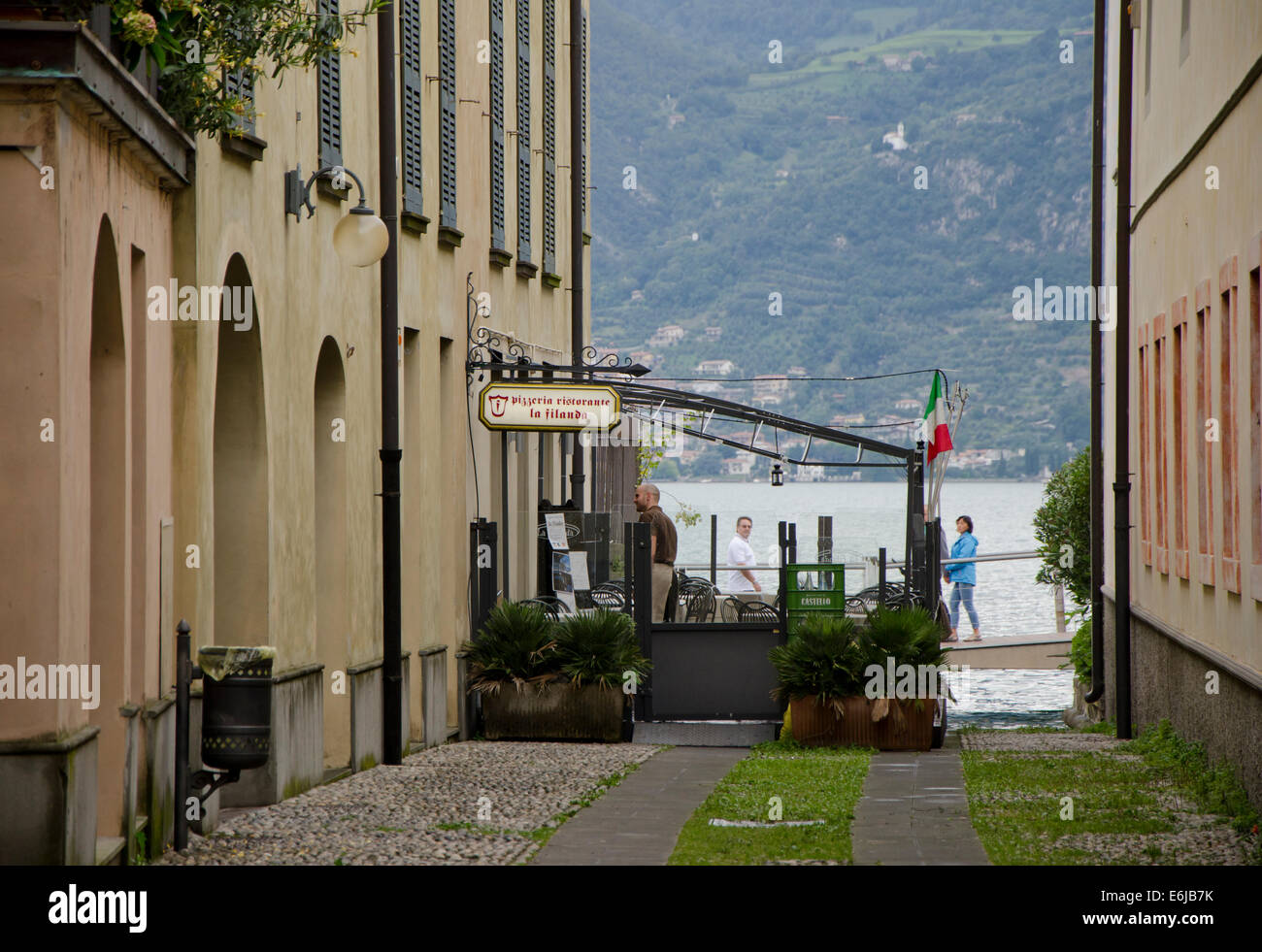 Lake Iseo or Lago d'Iseo or Sebino with a pizzeria restaurant at Iseo, Lombardy region. Northern Italy. - Stock Image