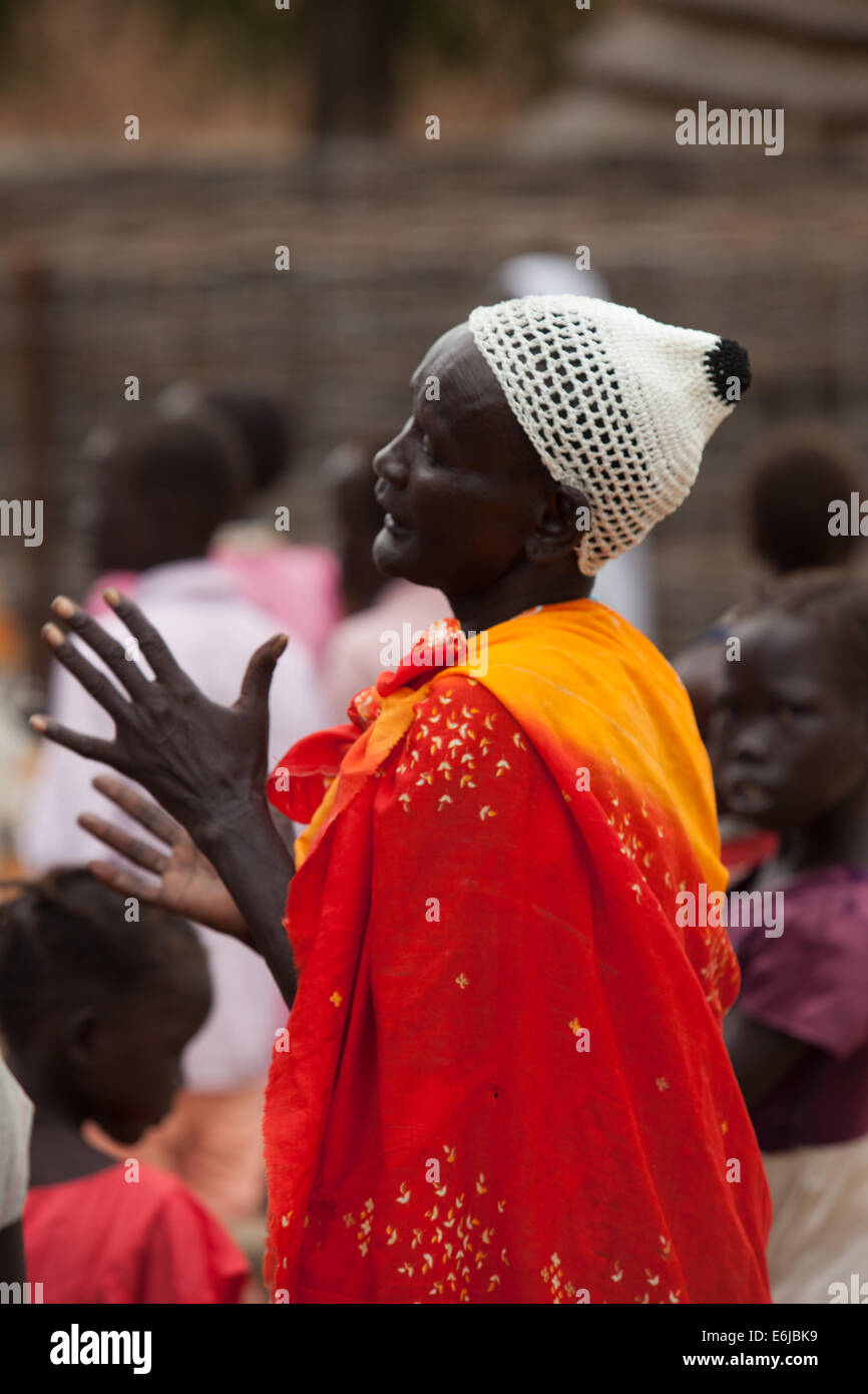 Woman in congregation at mass at Agok Catholic Church, Abyei. - Stock Image