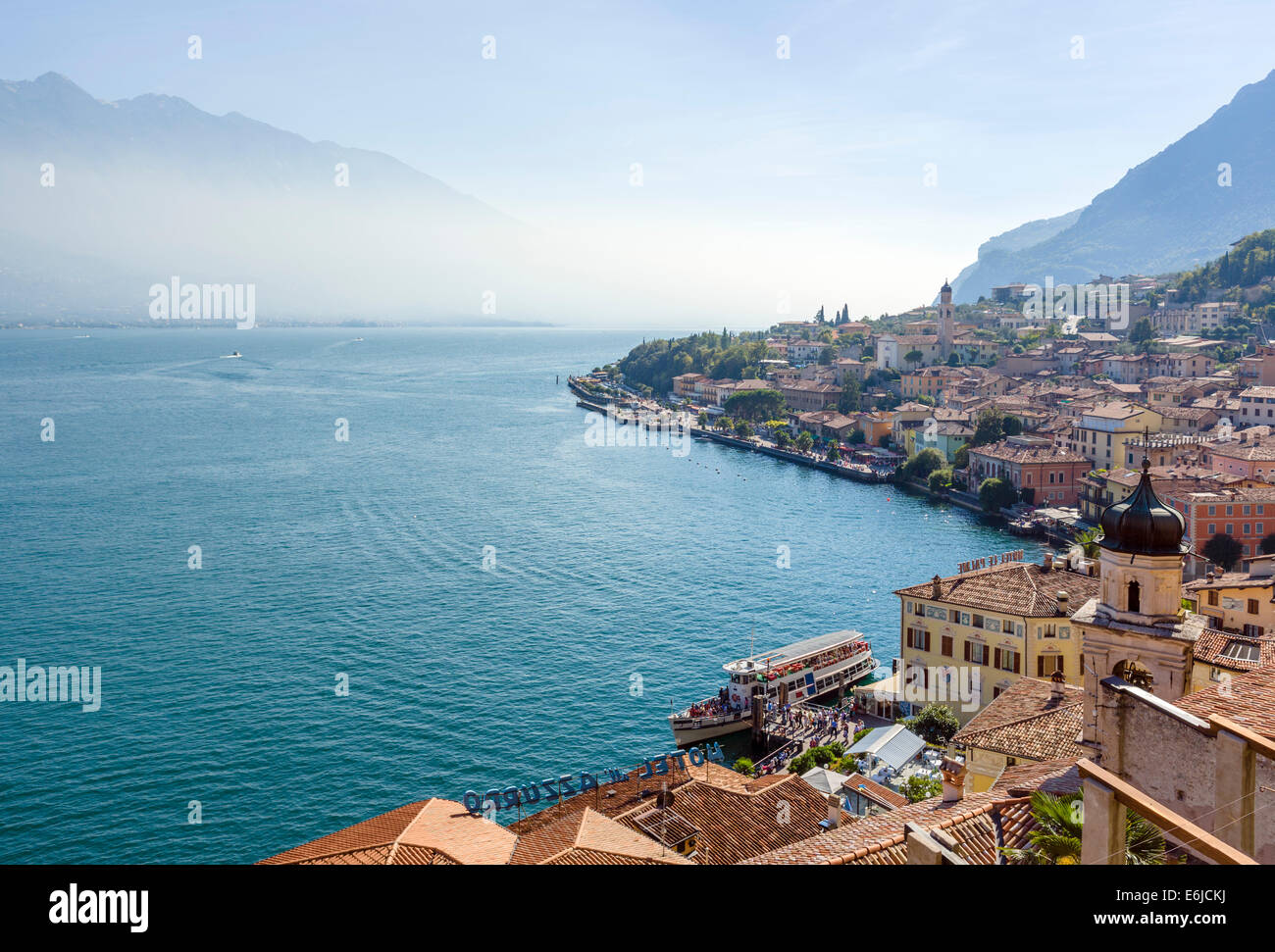 Ferry docked at the harbour in Limone sul Garda, Lake Garda, Lombardy, Italy - Stock Image