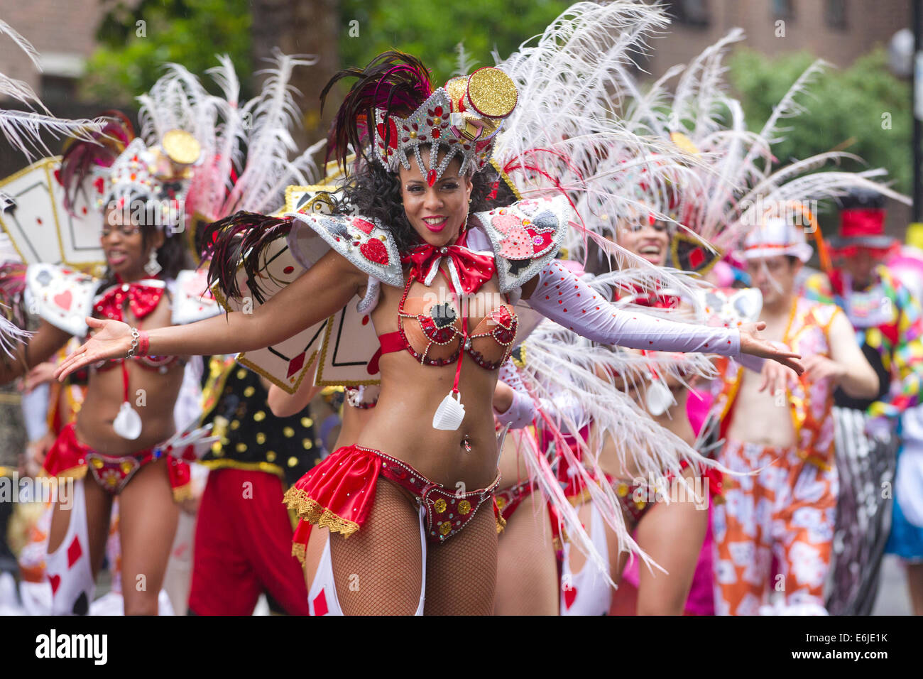 London, UK. 25th Aug, 2014. Carnival performers on a wet August Bank Holiday in the rain at The Notting Hill Carnival - Stock Image
