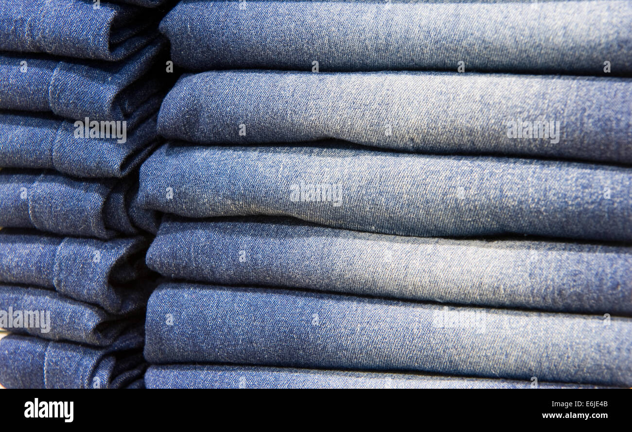 Blue jeans in a shop - Stock Image