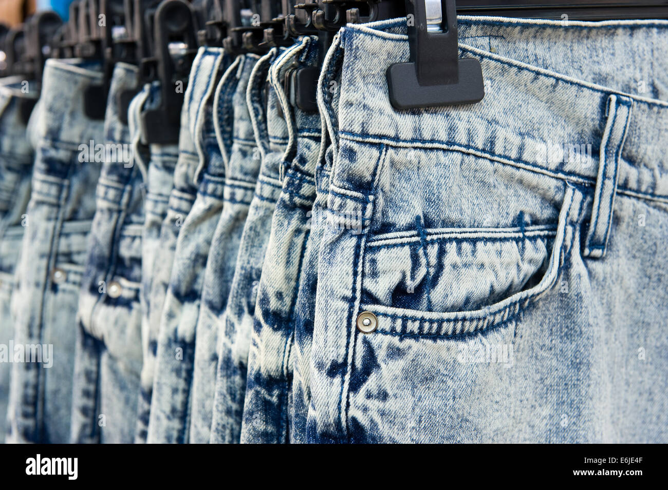 New blue jeans hanging in a shop - Stock Image