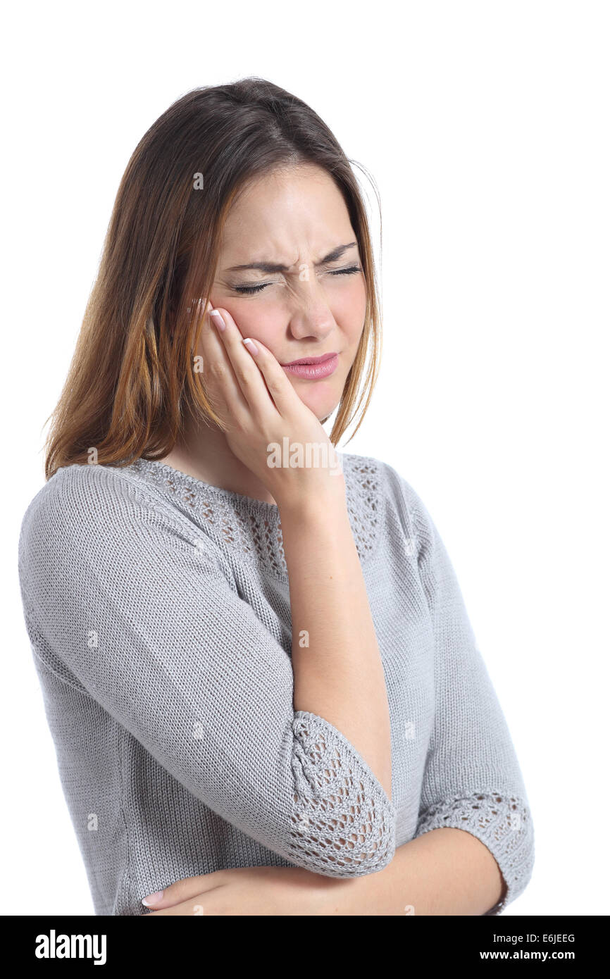 Woman suffering toothache with hand on face isolated on a white background - Stock Image