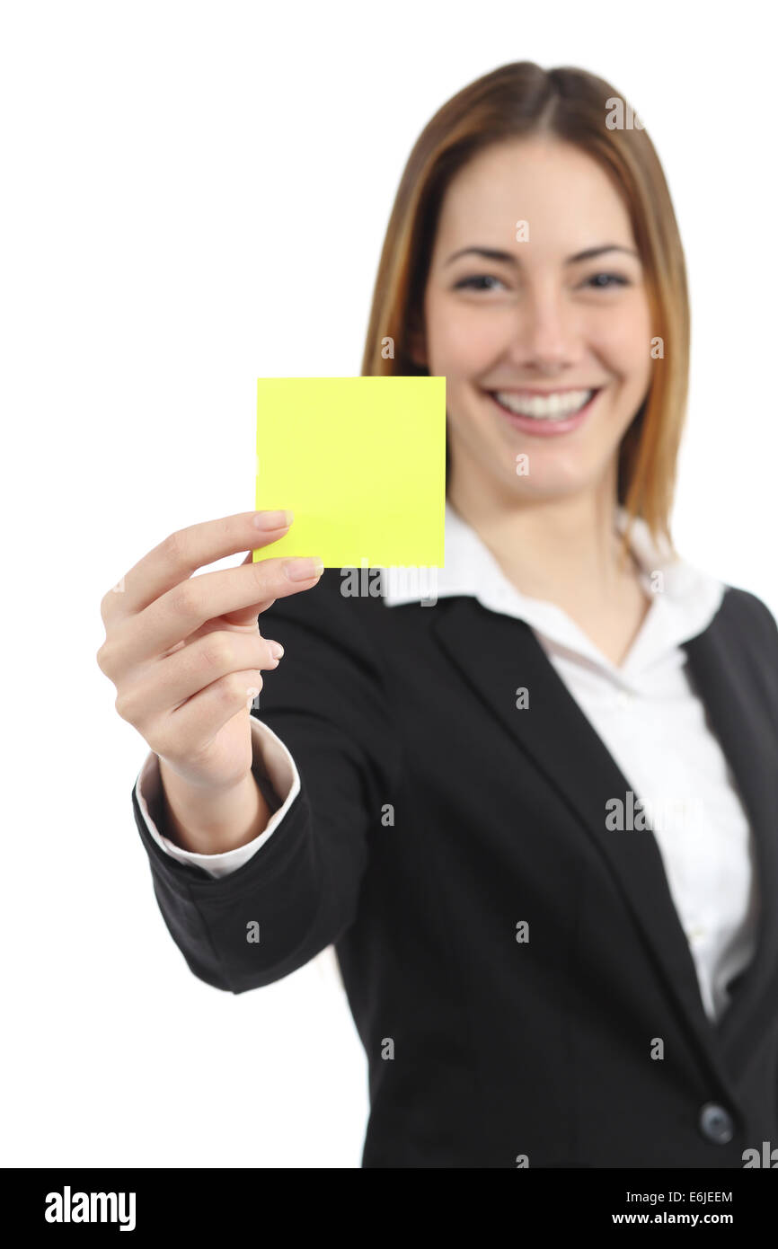 Beautiful businesswoman showing a blank yellow paper note isolated on a white background - Stock Image