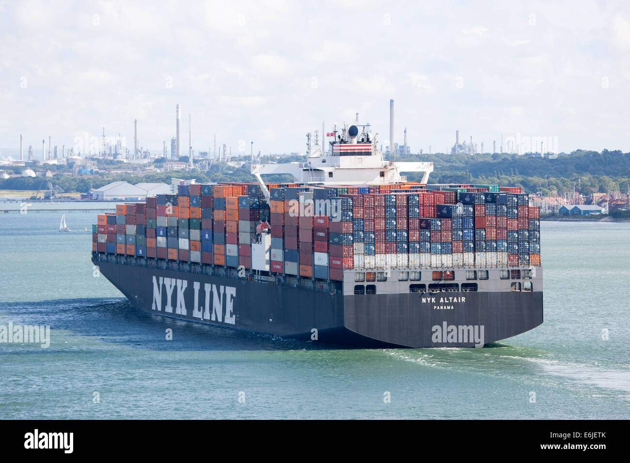 Container ship NYK Altair leaving Southampton dock with full cargo load - Stock Image