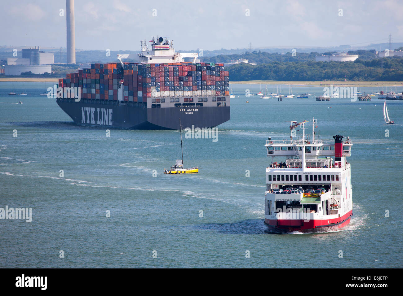 Southampton Docks NYK Altair container ship and Red Funnel Red Osprey car ferry - Stock Image