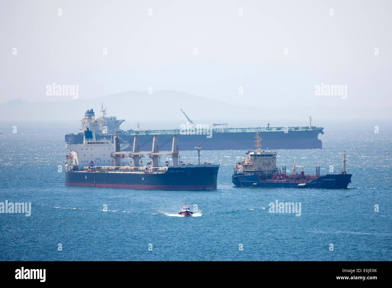 Orient Phoenix Bulk Carrier and Clipper Bricco Oil Chemical Tanker merchant ships in the Mediterranean sea Gibraltar - Stock Image