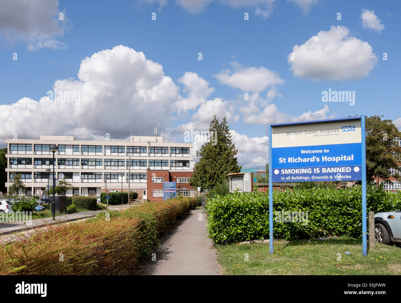 Sign at entrance to St Richard's Hospital warning 'Smoking is banned' in grounds and buildings Chichester - Stock Image
