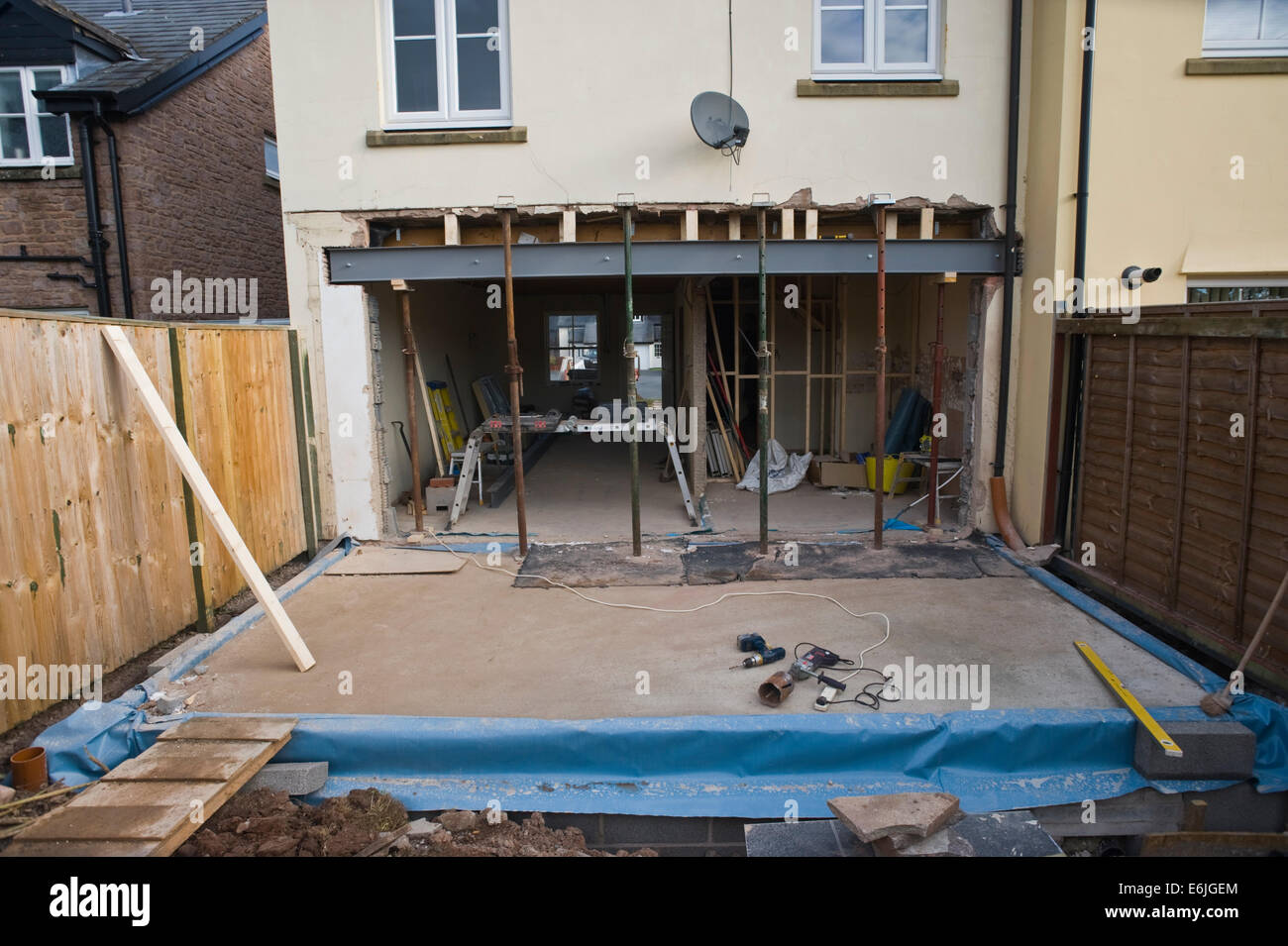 Rear wall knocked out and steel beam inserted for house extension Hay-on-Wye Powys Wales UK - Stock Image