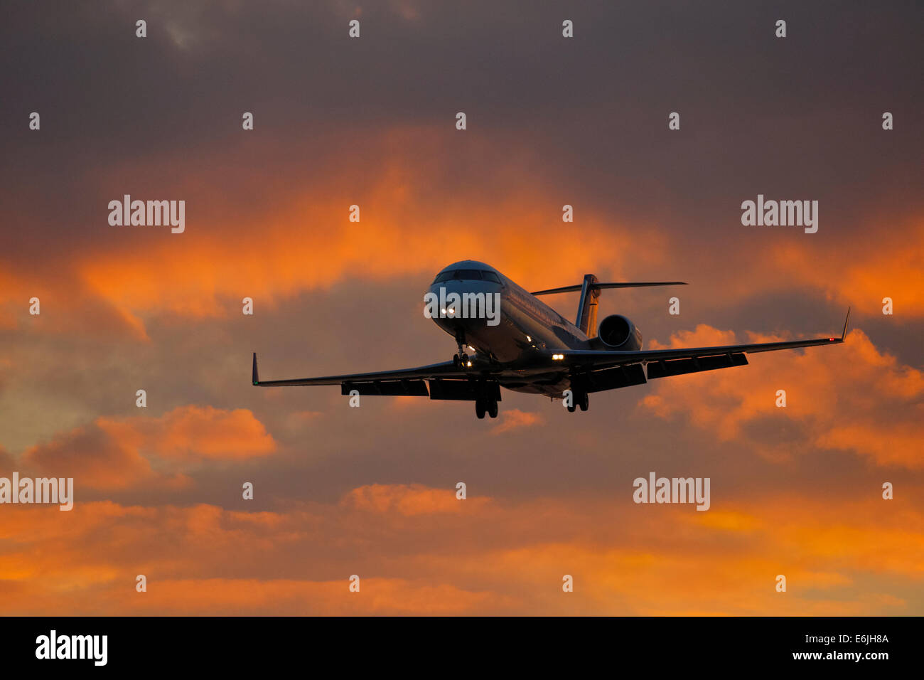 Commercial airliner United Express Bombardier jet on final approach for landing-Victoria, British Columbia, Canada. - Stock Image
