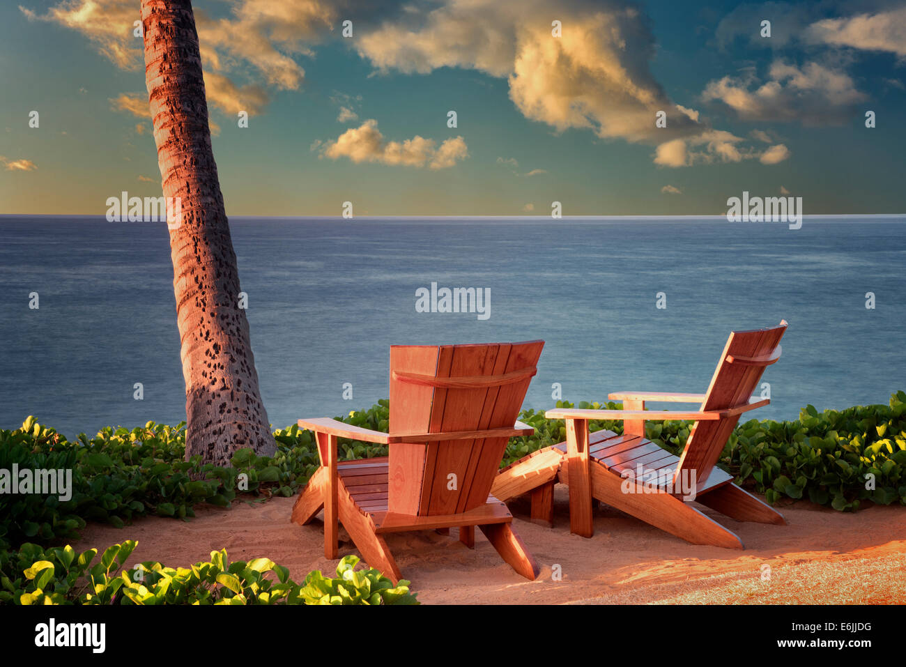 Two adirondac chairs overlooking ocean at Four Sesons. Lanai, Hawaii. - Stock Image