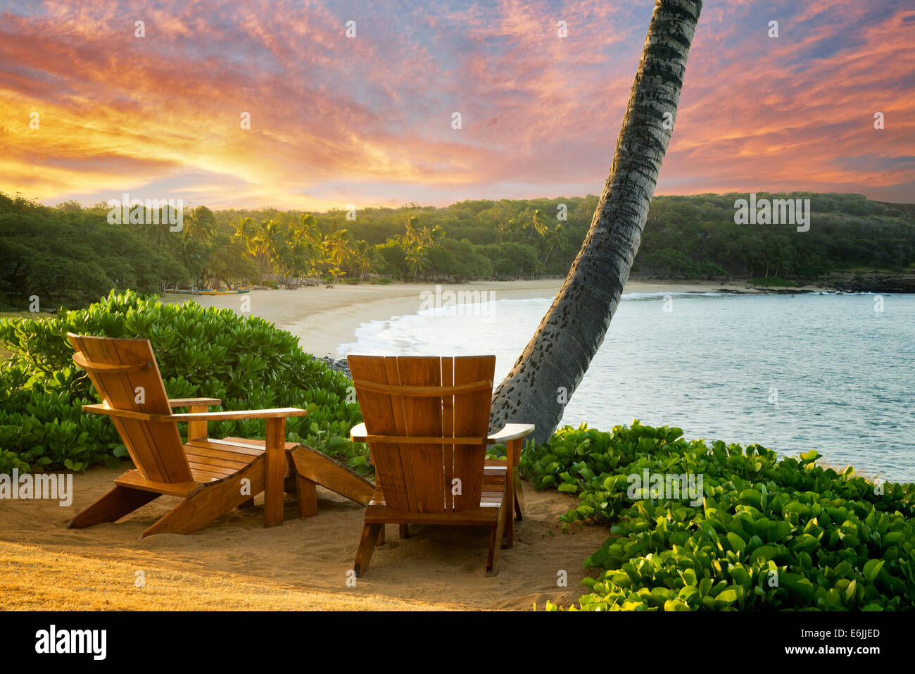 Two anirondac chairs overlooking ocean and beach at Four Seasons. Lanai, Hawaii. - Stock Image