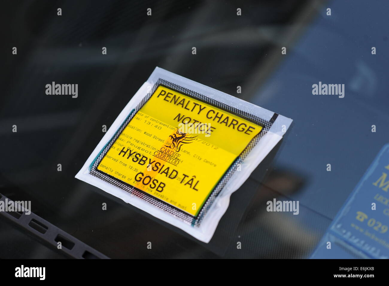A Welsh Penalty Charge Notice (PCN) parking ticket on a car windscreen issued in Cardiff, Wales. - Stock Image