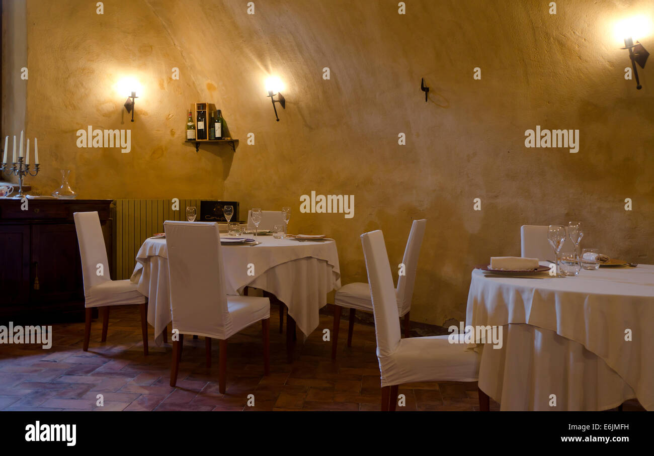 Set tables in classy restaurant in Italy. Lombardy. - Stock Image