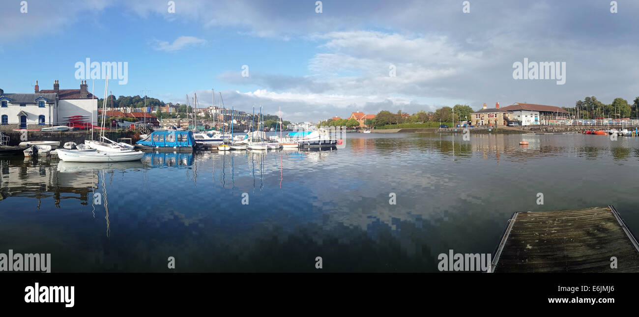 Bristol, UK Weather 25th Aug, 2014.  Late evening sun casts a golden glow over the floating Harbour in Bristol City - Stock Image