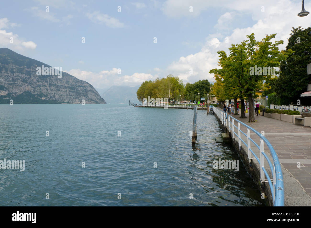 Lake Iseo or Lago d'Iseo or Sebino with the quai of Iseo  Lombardy region. Northern Italy. - Stock Image