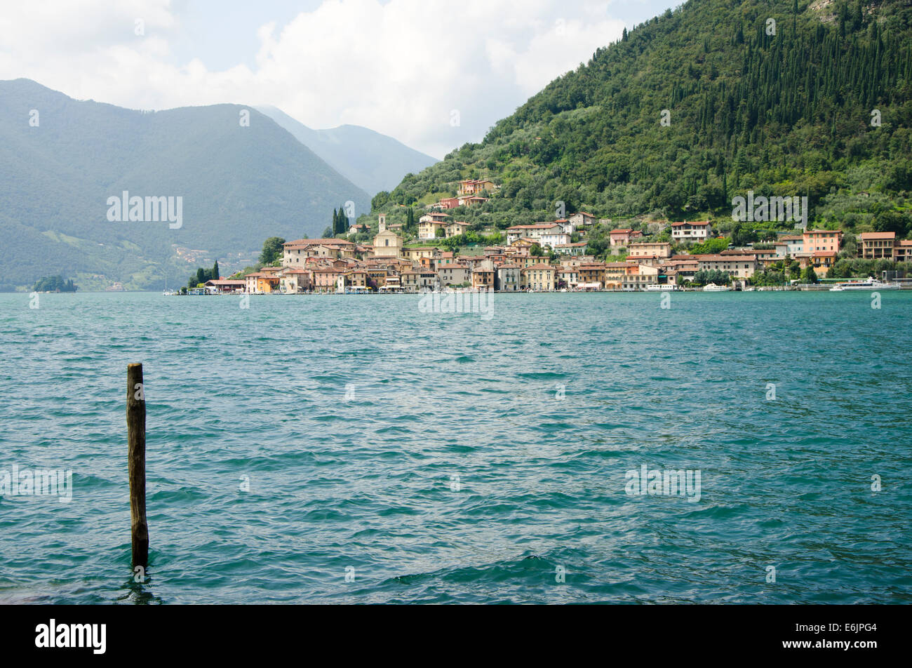 Lake Iseo or Lago d'Iseo or Sebino with the village Predore in the background. Lombardy region. Northern Italy. - Stock Image