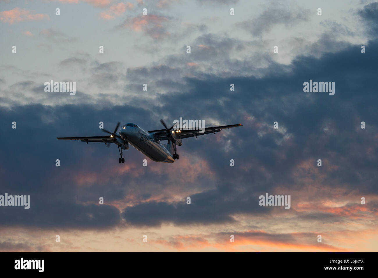 Commercial airliner Dash 8 Turboprop on final approach for landing-Victoria, British Columbia, Canada. - Stock Image