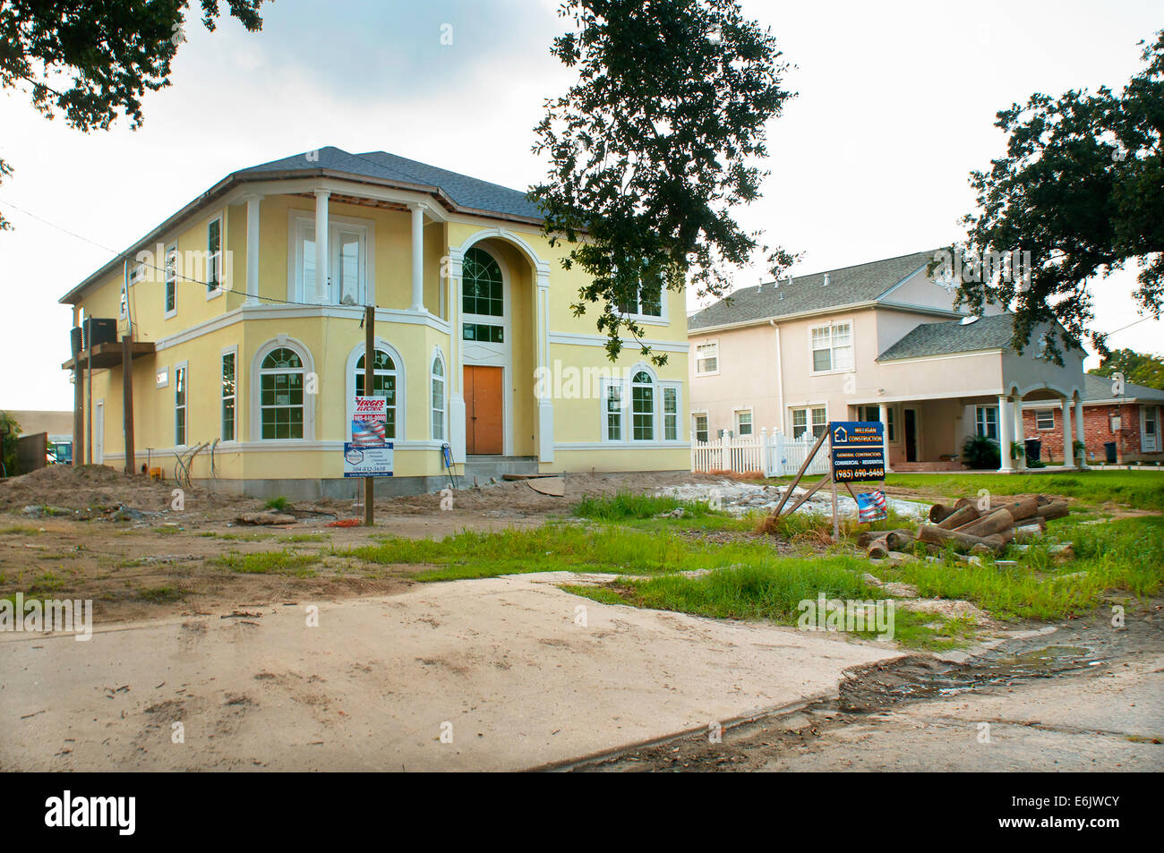 Residents rebuild, demolish homes and sell their land, or refuse to return to the 9th Ward after Hurricane Katrina - Stock Image