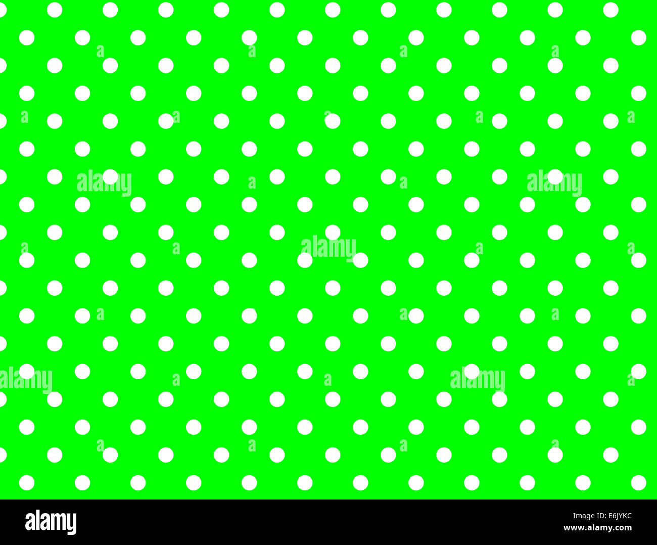 lime green background with white polka dots jpg stock photo