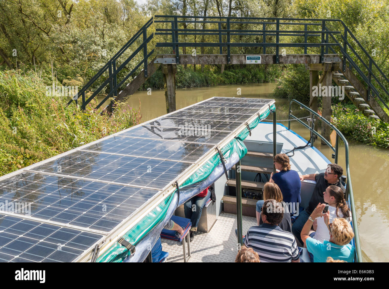 Solar powered boat with visitors in Biesbosch National Park freshwater tidal wetland in the Netherlands. - Stock Image