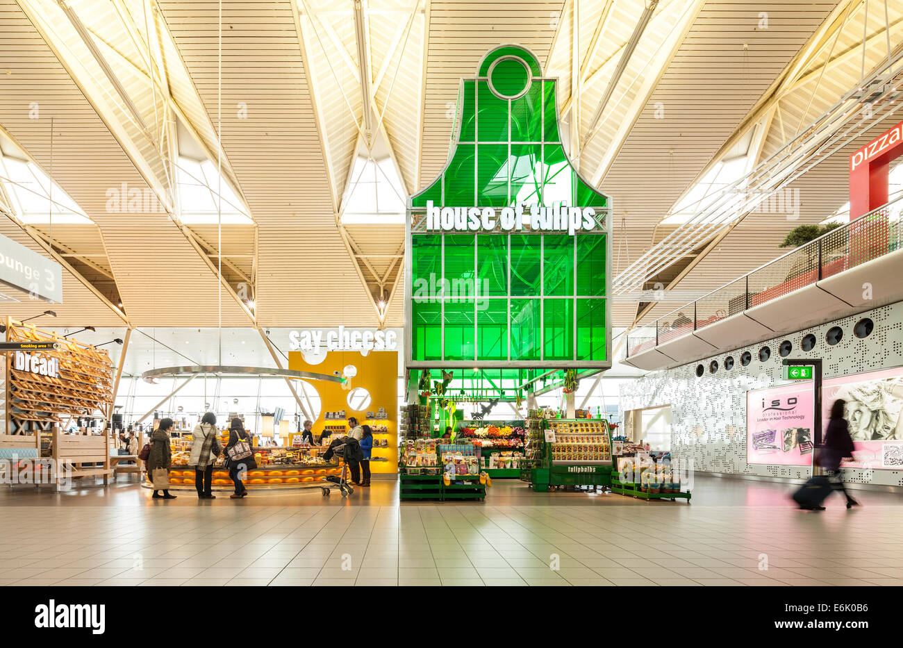 Amsterdam Schiphol Airport departure lounge 3 with Tulips Cheese souvenir souvenirs shop shops store stores passengers - Stock Image