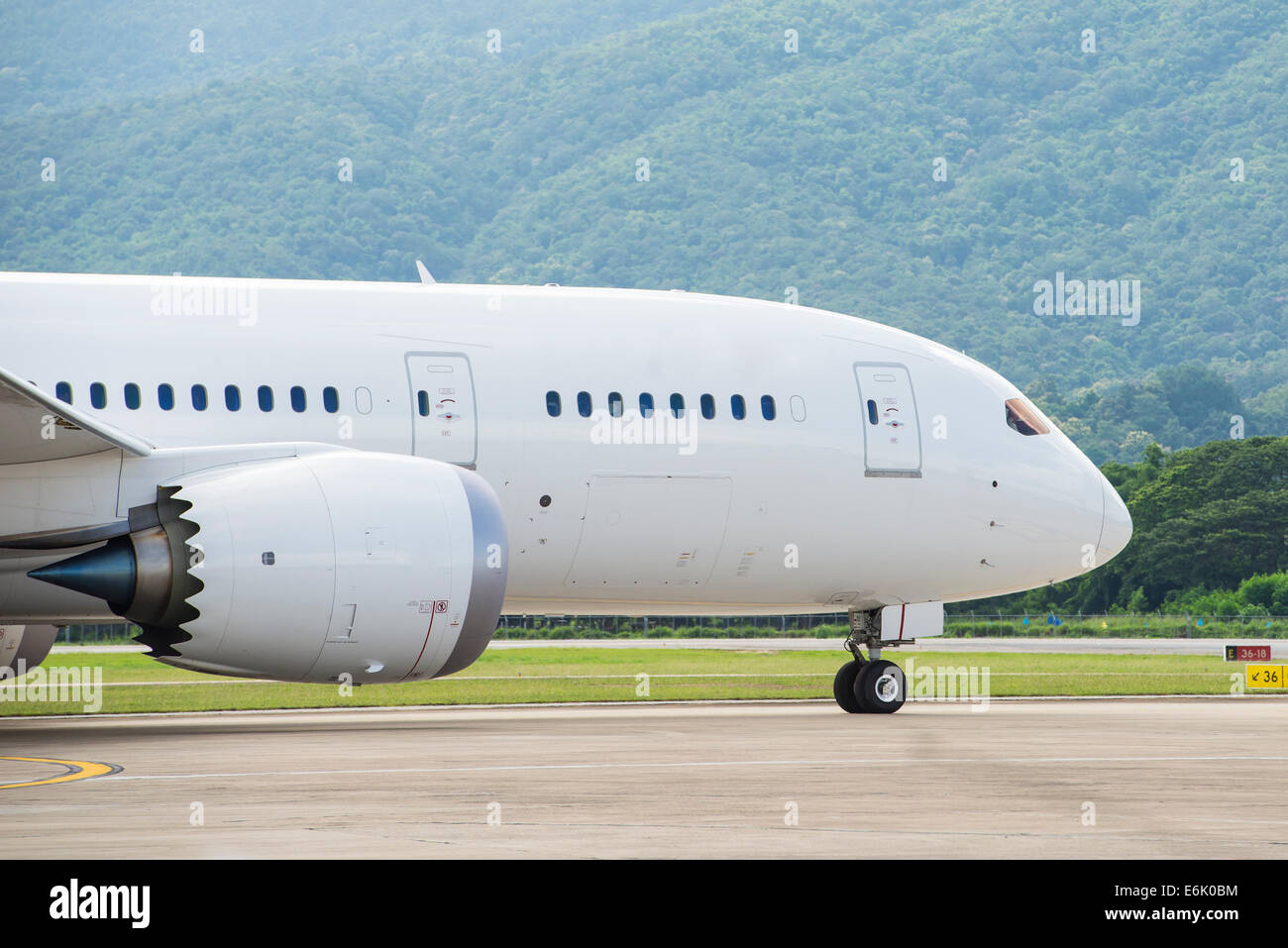 Commercial airplane taxiing to runway - Stock Image