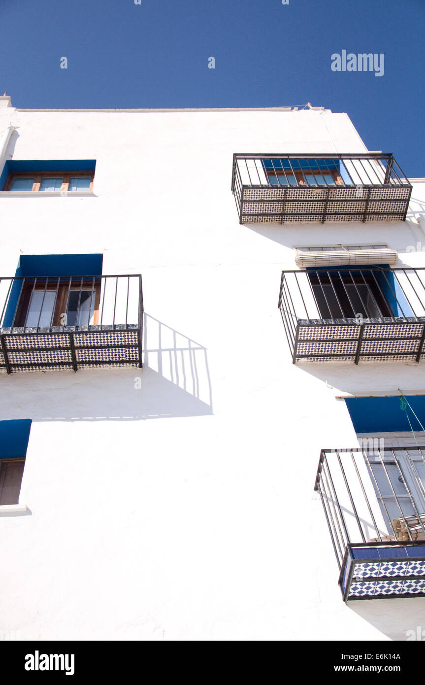 A typical Mediterranean whitewash facade with glazed tiles in the balconies - Stock Image