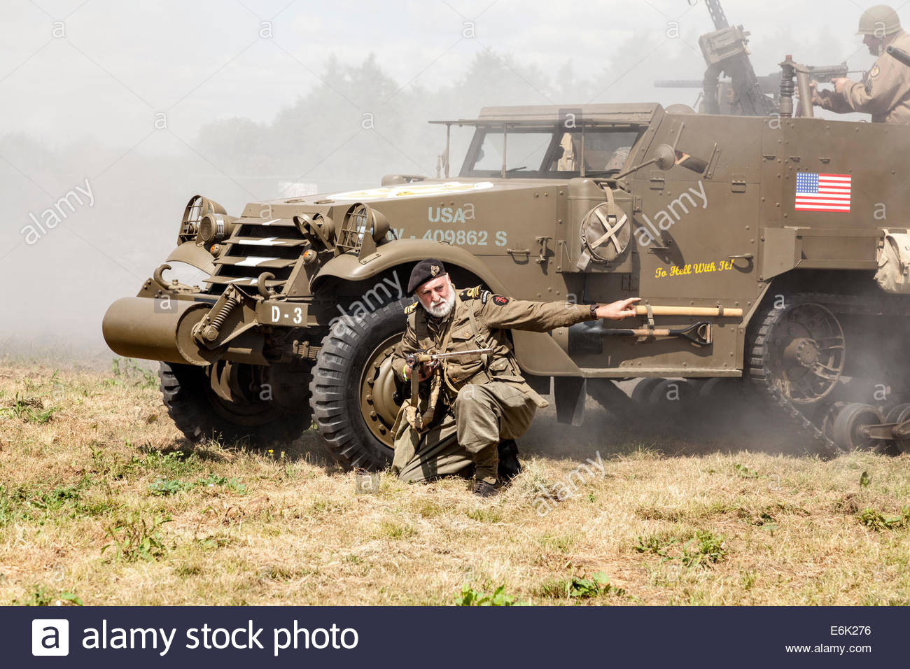 World War Two re-enactment featuring a US army half-track and a Royal Navy Commando - Stock Image