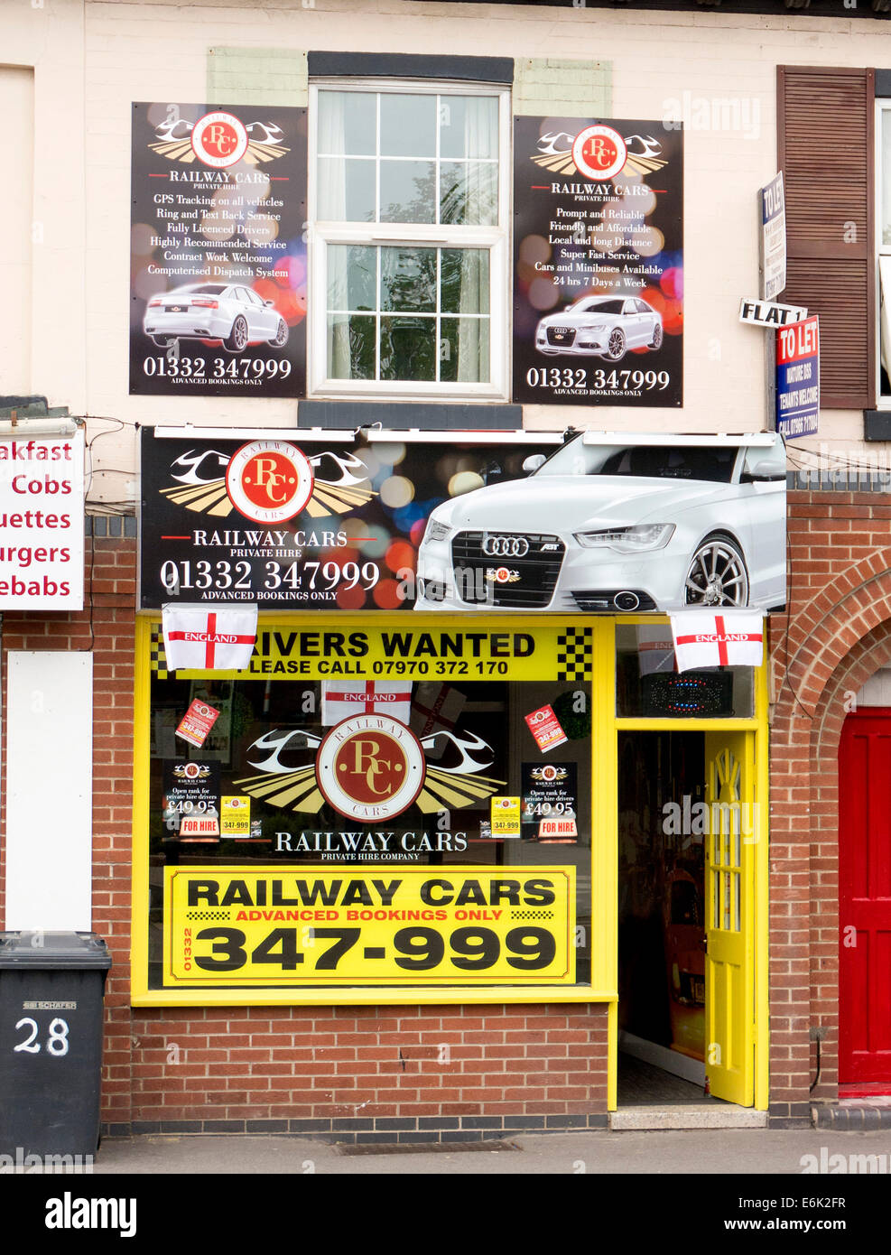 Exterior front of 24 hour minicab company in Derby Stock Photo