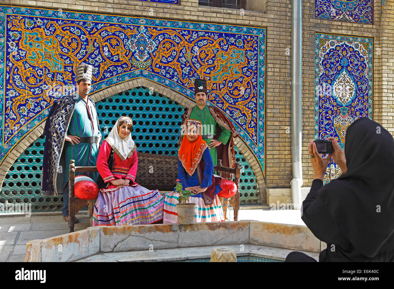 Wedding couples having their pictures taken in traditional costume, Golestan Palace, UNESCO World Cultural Heritage - Stock Image