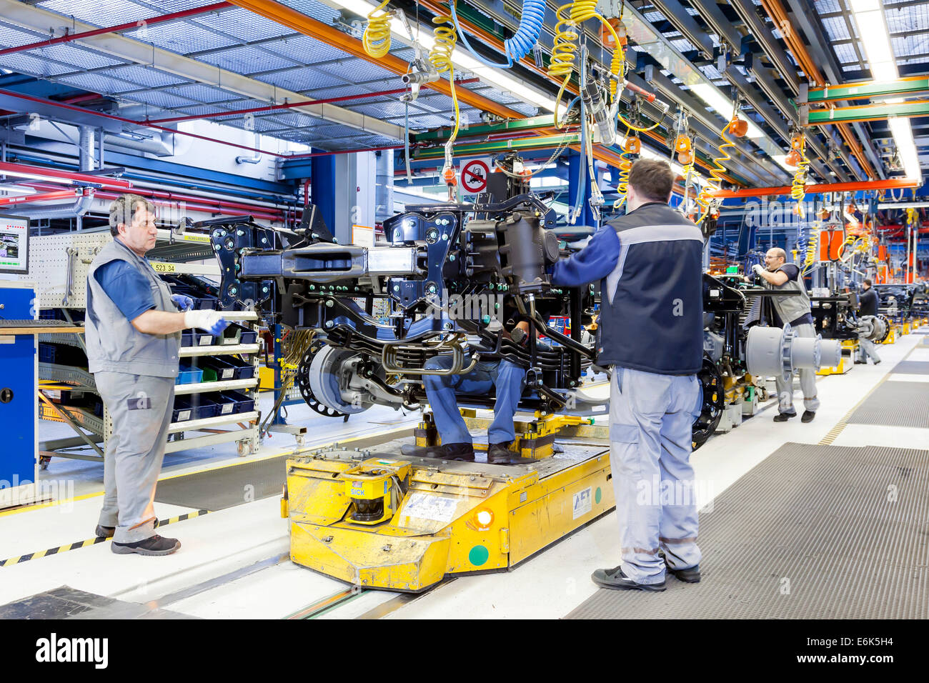 Employees assembling a chassis at MAN Truck and Bus AG