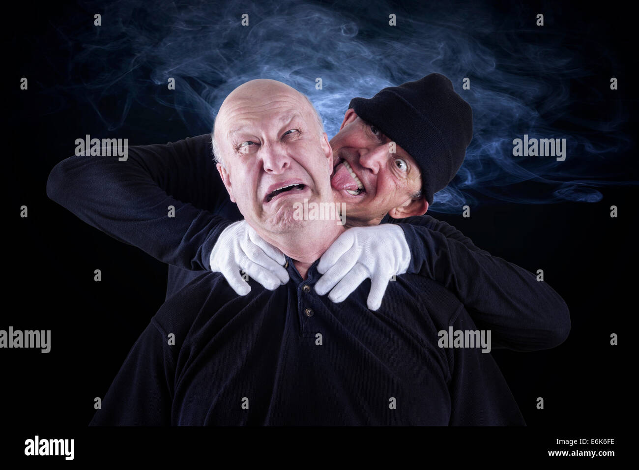 Senior citizen, 62 years, choking his partner, 55 years, after a dispute - Stock Image