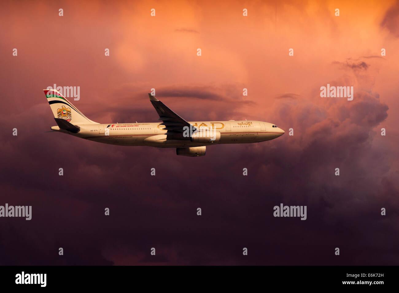 Etihad Airways, Airbus A330-243, in flight, in the evening light - Stock Image