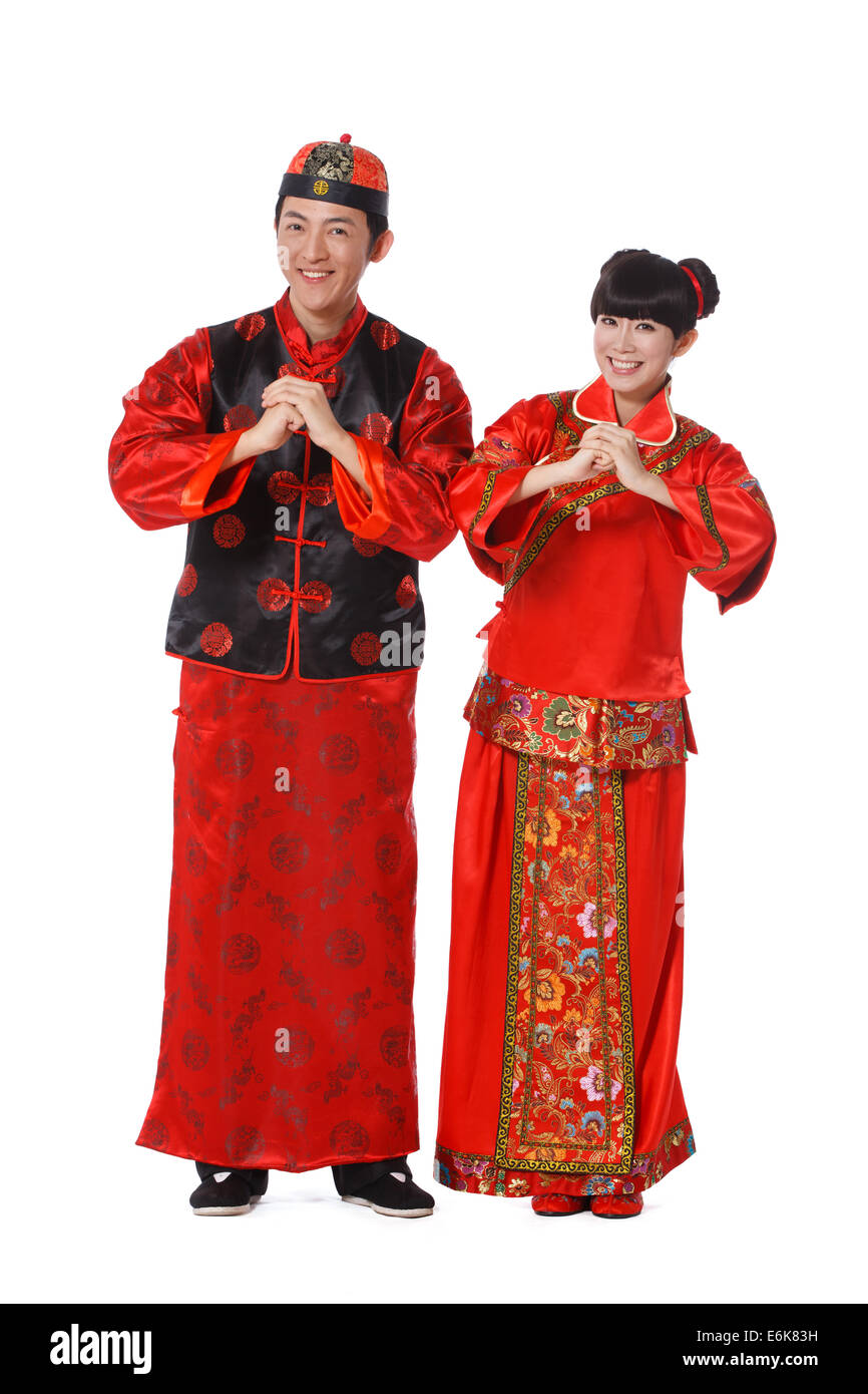 ccba41e05 Young couple dressed in Chinese traditional clothes celebrating Chinese New  Year