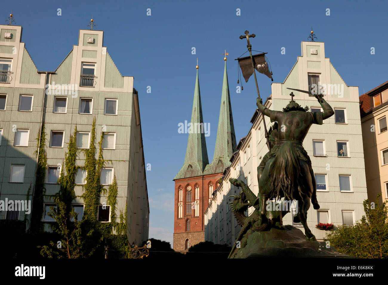 St George the dragon-slayer and Nicholas' Church,  Nikolaiviertel or Nicholas' Quarter in Berlin, Germany, - Stock Image
