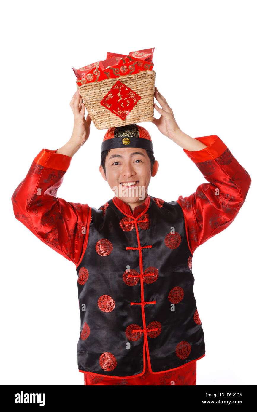 9f415f260 Young man in Chinese traditional clothes with red envelopes celebrating Chinese  New Year