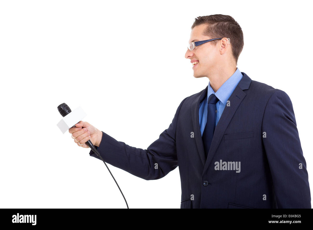 side view of journalist interviewing with microphone on white background - Stock Image