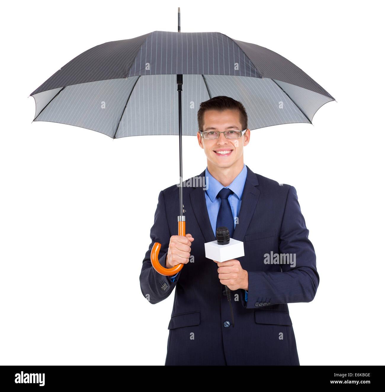 handsome news journalist holding umbrella over white background - Stock Image